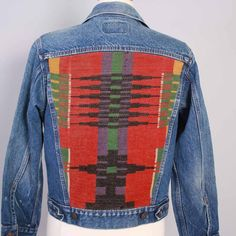 $125 vintage 1980s levis acket. custom - with one of a kind vintage native american blanket back patch panel. classic 4 pocket style. perfectly broken-in mid-wash blue denim. style 78735-0214. unisex.  label: levis  size marked: M best fits modern medium. see measurements to be sure. chest: 37 shoulder: 17 sleeve: 22 length: 21  excellent pre-owned condition - no damage, stains or flaws. perfectly broken-in.  More Vintage Jean Jackets and Vests HERE: http://etsy.me/1qAsP7K  Instagram…