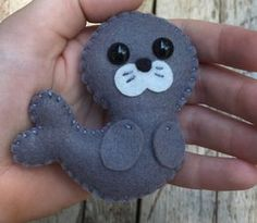felt art This little soft wool felt seal / sea lion ornament / key chain is an original design by myself which is hand cut, sewn and stuffed with cotton. Keep in mind the picture listed above Easy Felt Crafts, Felt Diy, Felt Christmas Ornaments, Diy Christmas Gifts, Kids Christmas, Craft Projects, Sewing Projects, Felt Projects, Knitting Projects
