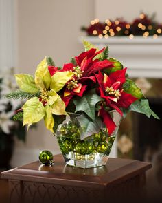 Silk Mixed Poinsettia Centerpiece | Add Seasonal Bling to Your Holiday Décor from Silkflowers #Silk #Centerpiece #Seasonal #Decor #Flowers #Christmas
