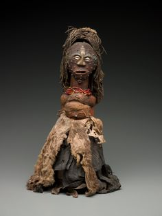 Africa | Power figure from the Songye people of DR Congo | Wood, fabric, vegetal fiber, metal and glass beads.