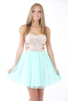 The cutouts on the beaded bodice of this dress are so cute!