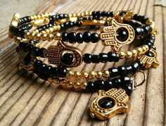 Hey, I found this really awesome Etsy listing at https://www.etsy.com/listing/268065787/black-and-gold-hamsa-bracelet