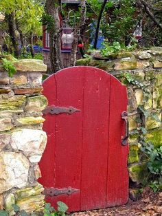 Red Garden Gate with Stone Fence.