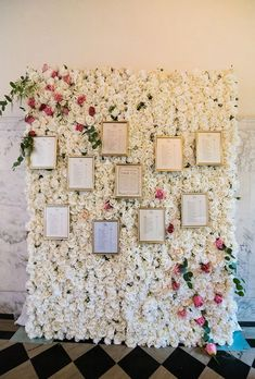 Brides.com: . A lush flower wall of roses — decorated with framed seating charts — is a stunning way to invite guests to locate their seat at the reception. Created by Alina Fioré Floral Design Studio.