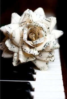 Music & Soul | Paper rose made of musical sheet music.