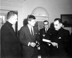 Fr. Hesburgh presented President John F. Kennedy  with the Laetare Medal in the Oval Office. The Laetare Medal is the most prestigious award given to American Catholics.