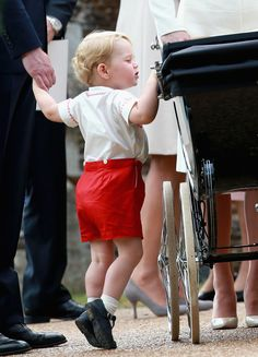 July 5, 2015 - Although Sunday's christening marked a special occasion for Princess Charlotte, her big brother stole the spotlight with his adorable facial expressions. Prince George couldn't have been cuter as he walked hand in hand with his parents, Prince William and Kate Middleton, as they made their way to the church with Princess Charlotte in her pram.