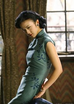 Cheongsam: An everlasting elegance---- I love that print! This is Chinese actress Tang Wei in a scene from Ang Lee's movie Lust Caution.  Please see below comment for more info! Thanks Paul for the interesting info.