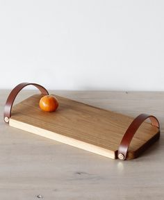 We've got a bit of a thing for serving boards, and the latest one on our lust-list is this handmade board with leather handles from Lostine. The Fitler's Handle Tray would be a beautiful addition to any feast or party spread.