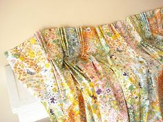 How to turn pleated vintage curtains into non-pleated curtains! Get rid of those tacky pleats! from Happy-Go-Vintage HOUSE blog