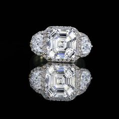 3.5ct. Asscher cut center w/halo settings set with zirconite half moon sides (.75ct each) vintage ring simulated diamond -diamond veneer® set in sterling silver platinum electroplate.