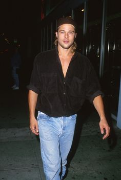 Brad Pitt  hid his longer locks under a backward baseball cap during a night out in LA in January 1992.