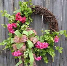 Spring Wreath  This bright spring wreath is characterized by gorgeous bright pink peach tree blossoms and green salvia. Bright ivy makes a lovely
