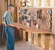 wall mounted workbench made from prehung door, could try something similar with…