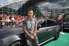 Thiago Alcantara of FC Bayern poses with his new Audi car during the official car handover at Audi Forum on August 22 2016 in Ingolstadt Germany