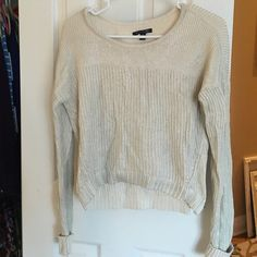 Cream/silver metallic sweater from American Eagle 100% cotton. Cream sweater with threads of silver throughout. Worn once. No pulls or holes American Eagle Outfitters Sweaters Crew & Scoop Necks
