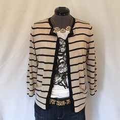 Beautiful Ann Taylor Tan & Black Stripe Cardigan Beautiful Lightweight Cardigan! This Cardigan Never Goes out of Style! Classic tan & black stripes, Super Soft material. Full button up front, 3/4 length sleeves. Back of neck to hem is 22 inches. Bust measured flat is 17.5 inches. 40% rayon, 30% nylon, 25% polyester, 5% wool. Tag says Medium but I really think it's a Small, it's fits me perfect and I'm a Small. Please measure yourself to get an idea of the fit. This is a Wardrobe Staple…