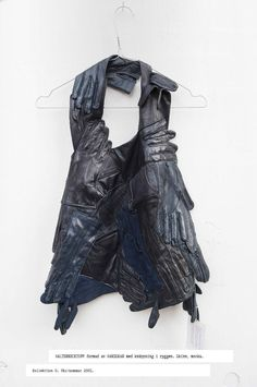 Halterneck top formed by gloves with buttoning in back by Maison Martin Margiela. Leather, suede. Collection 0. Spring/summer 2001.