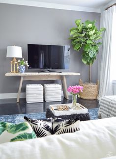tv wall fiddle leaf fig in basket toulouse ottoman cubes black and white gold bamboo lamp blue vintage inspired rug gray accent wall summer home tour -4