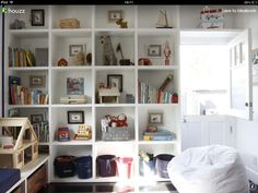 Great use of wall space for toy storage.