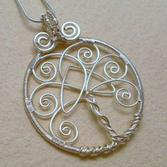 Tree of Life Pendant Necklace With Celtic Trinity Knot, Silver Plated Wire Wrapped Jewelry from AnnaWireJewelry on Etsy. Saved to Anna Wire Jewelry. Wire Pendant, Wire Wrapped Pendant, Wire Wrapped Jewelry, Wire Jewelry, Pendant Necklace, Tree Of Life Jewelry, Tree Of Life Pendant, Wire Crafts, Jewelry Crafts