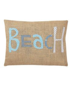 Reminiscent of sack races on the dunes of Cape Cod, this burlap pillow brings a bit of beachy fun to any room.