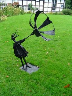 Steel Recycled Materials/ Objets trouvees sculpture by artist Zeljko Ivankovic titled: 'The Wind and a Girl (and Umbrella Steel Sculptures)' #sculpture #art