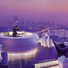 Four season hotel, Mumbai, India - This outdoor bar in the hotel has been thought out well I think as you can see the Mumbai geometrical buildings in the distance with the curved bar and seating in the bar.