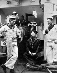 Three Royal Navy sailors having a smoke and chat - early 20th Century