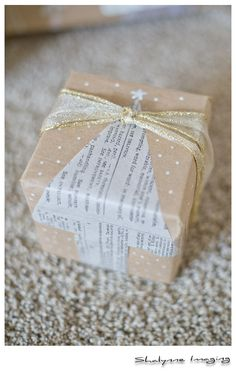 DIY Wrapping Paper, Newspaper Cutout tree, Paint Pen on Kraft Paper. Simple. Copyright: Shalynne Imaging