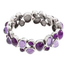 """Lyra-Purple Bracelet A classic style, featuring perfect dew drops of glistening color. Wear it alone or stack it with other bracelets for a look that's all your own. Lyra Collection  •  Silver tone  •  7"""" length  •  Elastic   https://myfashions.graceadele.us/GraceAdele/Buy/ProductDetails/11082"""