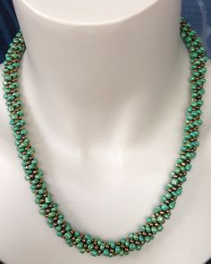 Green and gold beaded kumihimo spiral patterned necklace.  Earthy green beads pair with gold metallic beads to create a beautiful look. by NStapleyDesigns on Etsy