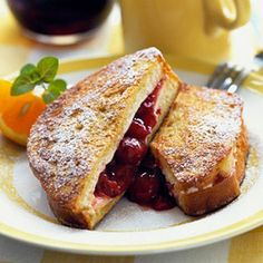 Very Cherry French Toast: Tuck cherry pie filling and cream cheese between cinnamon-flavored bread Slices. Recipe: www. French Toast Rolls, Nutella French Toast, French Toast Bake, Best Brunch Recipes, Favorite Recipes, Breakfast Recipes, Breakfast Ideas, Cannoli, Ricotta