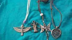 Locally cast pewter charms:  Isis, Merlin with inverted pentagram (shop damaged), sprite ~ fairy and heart-0-gram...check it out on ebay seller ofearthandfiredesignsd
