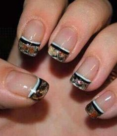 Maybe I'd go with a manicure like this for my nails since I don't think I want to wear all that much camo myself at my wedding, since I kinda want to stick with wearing a more traditional wedding dress. These could be a nice accent to go with the other camo I want in the wedding though! #CamoWeddingIdeas