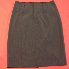 """High waist Guess Pencil Skirt Charcoal grey Guess pencil skirt with a high waist, skirt measures 22.5"""" long and 15"""" waist. Buttons in the front. Tag states it's a size 30 so I estimated this to fit anywhere from a 6 to an 8. Guess Skirts Pencil"""