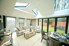 Create a perfect conservatory extension. Find small conservatory ideas and modern conservatory inspiration on our website. Contact us for conservatory prices. Conservatory Prices, Modern Conservatory, Conservatory Kitchen, Conservatory Design, Kitchen Ceiling Design, Garage To Living Space, Local Furniture Stores, House Extensions, Kitchen Extensions