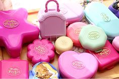 Polly Pocket old style! I probably owned 80% of these in this picture. And then the company finally realized that kids choked on the pieces. LOL