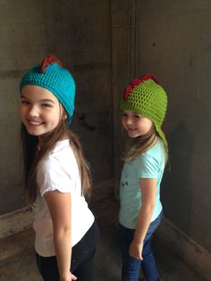 Adorable Handknit kids' dino hats. All profits go to the refugee artist to better her life here in the states.