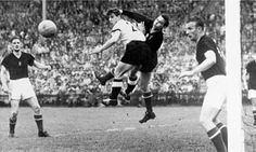 Hungarian goalkeeper Gyula Grosics and German striker Hans Schäfer tangle during the 1954 World Cup final.