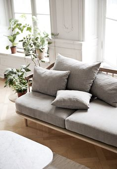 Slim furniture, neutral shades and some greenery add a lovely freshness to a space.