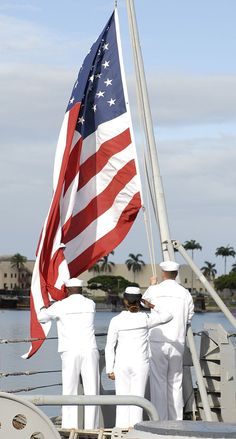 Sailors hoist the American flag for morning colors before the 67th anniversary of the end of World War II aboard the Battleship Missouri Memorial. #americasnavy #usnavy