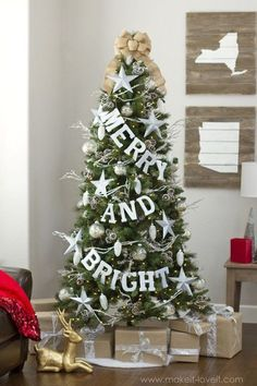 Beaded garland strands, spray-painted metal stars, and pinecone clusters cover this dazzling tree, but the main attraction is the bright, glittered letters hanging from jute string.