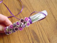 "After seeing editorials and runway shows full of flowered headbands I decided I needed one.  I made this delicate version from some pretty mulberry paper flowers in a range of purple shades with a dark purple satin ribbon to cover the headband.   Using 1/8"" ribbon is faster, but 1/16"" ribbon gives you more control Read More"