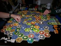 Settlers of Catan: wow that is a HUGE board. They must have like a mega expansion set