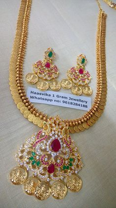 Price: Rs.3000.<br>Beautiful lakshmi kasu peru haaram with huge pathakam locket having peacock design and lakshmi kasu hangings.<br>Earring also in locket style have red and green stones studded . 24 February 2018