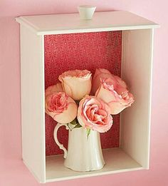 In the Shadows  Use a drawer from a damaged or discarded dresser as a shadow box. A fresh coat of paint and a leftover piece of wallpaper or scrapbook paper taped inside turn a useless drawer into a work of art.