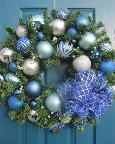"""ELM Boutique pine wreath - Fresh colors of light & medium blues with a touch of silver - beautiful for Christmas, Hannukah , and even into January !! 24"""" full pine wreath with silver berry garland, and shatterproof ornaments, and a full bow."""