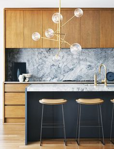 There's something downright sexy about a shiny brass chandelier with a balance of geometric lines and spheres. Against a more minimal, modern design, this multi-arm version adds a glam touch to a...