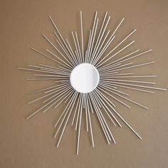 Spray paint wooden skewers to make a quick starburst mirror.